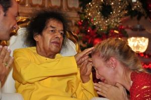 Swami, Sri Sathya Sai Baba blessing a devotee